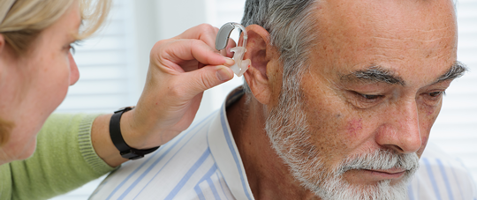 Patient Being Fitted with Hearing Aid